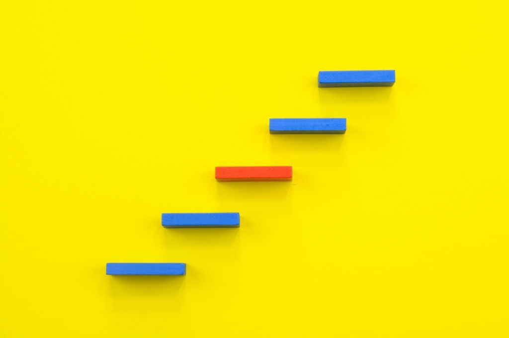 Steps to Success. Blue and Red steps on a yellow background.